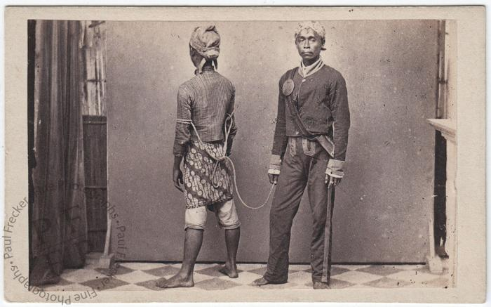 Javanese policeman with a prisoner