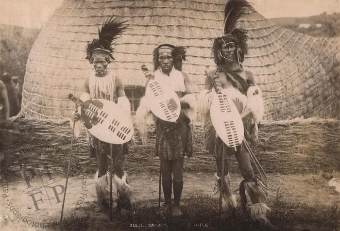 Three Zulu warriors