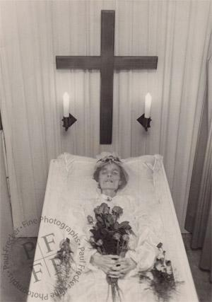 Elderly woman in an open coffin