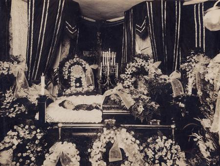 Woman in a half-couch casket