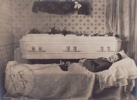 Man next to a white casket